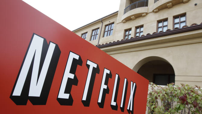 "FILE - This March 20, 2012 file photo shows Netfilx headquarters in Los Gatos, Calif. Netflix on Thursday, Oct. 8, 2015 announced it is raising the price of its Internet video service by $1 in the U.S. and several other countries to help cover its escalating costs for shows such as ""House of Cards"" and other original programming. (AP Photo/Paul Sakuma, File)"