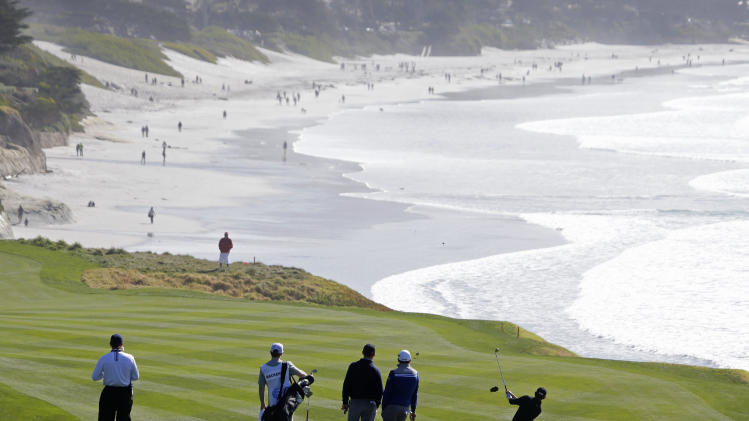 Patrick Cantlay, right, hits from the fairway down to the ninth green of the Pebble Beach Golf Links during the third round of the AT&T Pebble Beach Pro-Am golf tournament Saturday, Feb. 9, 2013, in Pebble Beach, Calif. (AP Photo/Eric Risberg)