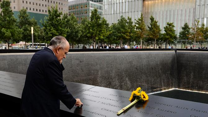 Former New York City Mayor Rudolph Giuliani stands at the edge of the North Pool during memorial observances on the 13th anniversary of the Sept. 11 terror attacks on the World Trade Center in New York, Thursday, Sept. 11, 2014. In New York, family members of those killed at the World Trade Center will read the names of the victims at a ceremony at ground zero. (AP Photo/Justin Lane, Pool)