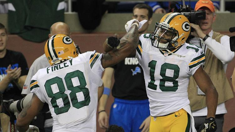 Green Bay Packers wide receiver Randall Cobb (18), celebrates his fourth quarter touchdown with teammate Jermichael Finley (88) in an NFL football game against the Detroit Lions at Ford Field in Detroit, Sunday, Nov. 18, 2012. (AP Photo/Carlos Osorio)