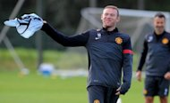 Wayne Rooney, pictured at the Carrington training complex in Manchester on Monday, has warned his Manchester United team-mates they will suffer a Champions League giant-killing unless they raise their game against Romanian minnows Cluj