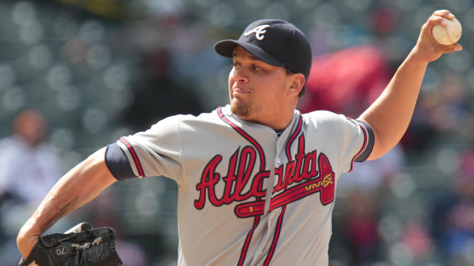 Atlanta Braves relief pitcher Luis Avilan (43) works against the Colorado Rockies during the seventh inning of the first baseball game of a doubleheader, Tuesday, April 23, 2013, in Denver. (AP Photo/Barry Gutierrez)