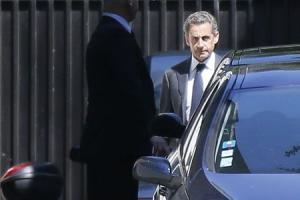 Former French President Nicolas Sarkozy leaves his residence in Paris