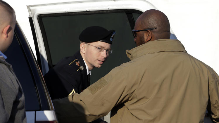 Army Pfc. Bradley Manning steps out of a security vehicle as he is escorted into a courthouse in Fort Meade, Md., Thursday, Nov. 29, 2012, for a pretrial hearing. Manning is charged with aiding the enemy by causing hundreds of thousands of classified documents to be published on the secret-sharing website WikiLeaks. (AP Photo/Patrick Semansky)