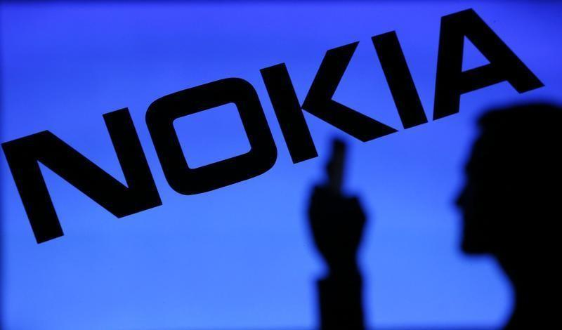 Alcatel-Lucent shares jump eight percent on Nokia merger report