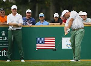 International team member de Jonge is watched by teammate Els of South Africa as he tees off the ninth hole during the opening Four-ball matches for the 2013 Presidents Cup golf tournament at Muirfield Village Golf Club in Dublin
