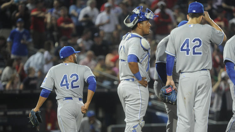 Kansas City Royals relief pitcher Kelvin Herrera, left, is relieved after allowing consecutive runs by the Atlanta Braves during the eighth inning of a baseball game, Tuesday, April 16, 2013, in Atlanta. (AP Photo/John Amis)