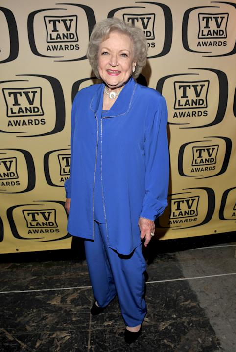 Betty in a cobalt pantsuit
