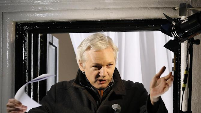 Julian Assange, founder of WikiLeaks gestures as he speaks to the media and members of the public from a balcony at the Ecuadorian Embassy in London, Thursday, Dec. 20, 2012. Assange who faces extradition to Sweden over sexual assault, claims which he denies, took refuge in the embassy in June. (AP Photo/Kirsty Wigglesworth)