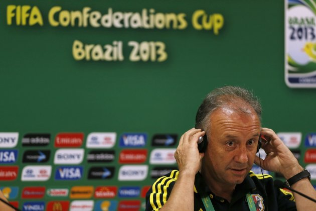 Japan's head coach Alberto Zaccheroni listens during a news conference at the Arena Pernambuco stadium in Recife