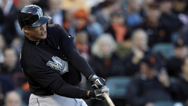 Florida Marlins' Mike Stanton drives in a run with a double against the San Francisco Giants during the first inning of a baseball game in San Francisco, Wednesday, May 25, 2011. (AP Photo/Marcio Jose Sanchez)