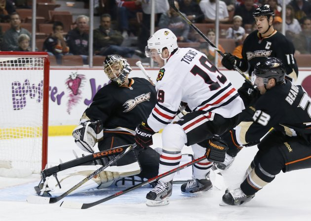 Chicago Blackhawks' Toews scores a short handed goal past Anaheim Ducks' goaltender Hiller while the Ducks' Beauchemin and Getzlaf defend during their NHL hockey game in Anaheim, California