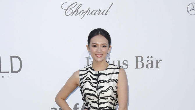 Actress Zhang Ziyi arrives at amfAR Cinema Against AIDS benefit at the Hotel du Cap-Eden-Roc, during the 66th international film festival, in Cap d'Antibes, southern France, Thursday, May 23, 2013. (Photo by Todd Williamson/Invision/AP)