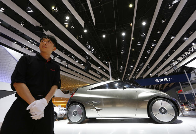 A Nissan Mixim concept car is displayed at the company's booth at the Guangzhou Auto Show in China's southern city of Guangzhou Thursday, Nov. 22, 2012. China's second largest auto show kicked off Thursday. (AP Photo/Vincent Yu)