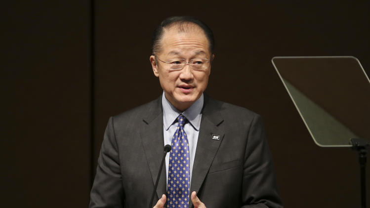 World Bank President Jim Yong Kim delivers a key note speech during a conference on Universal Health Coverage for inclusive and sustainable growth in Tokyo Friday, Dec. 6, 2013. Kim says ensuring greater access to affordable health care is a crucial factor in alleviating poverty and promoting economic growth. Kim announced Friday that the World Bank and World Health Organization aim by 2020 to reduce by half the number of people falling into poverty due to health care expenses. (AP Photo/Koji Sasahara)