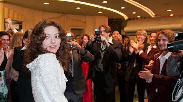 """This undated publicity photo released by the Sundance Institute shows Amanda Seyfried as Linda Lovelace in the film, """"Lovelace,"""" directed by Rob Epstein and Jeffrey Friedman. The Sundance Film Festival begins Thursday, Jan. 17, 2013, in Park City, Utah. This year's lineup of 119 feature films includes, Ashton Kutcher as Apple co-founder Steve Jobs in director Joshua Michael Stern's film biography """"jOBS""""; Amanda Seyfried as porn star Linda Lovelace in Rob Epstein and Jeffrey Friedman's """"Lovelace""""; Daniel Radcliffe as Allen Ginsberg in John Krokidas' beat-poet story """"Kill Your Darlings""""; and Ethan Hawke and Julie Delpy in Richard Linklater's """"Before Midnight,"""" a follow-up to """"Before Sunrise"""" and """"Before Sunset,"""" among others. (AP Photo/Sundance Institute, Dale Robinette)"""