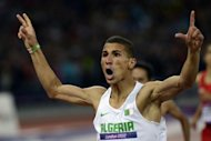 Algeria's Taoufik Makhloufi celebrates after winning the men's 1500m final at the London Olympics on August 7. Makhloufi said being disqualified from the London Olympics for not trying did not affect his focus after he came back to win the 1500m title just a day later