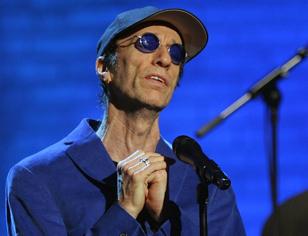 FILE - Robin Gibb performs during the &quot;Jose Carreras Gala&quot; rehearsal in Leipzig, eastern Germany, in this Dec. 14, 2006 file photo. The Sun newspaper reported Saturday April 15, 2012 that 62-year-old Gibb is in a coma, citing a family friend. British media reports say former Bee Gee Robin Gibb is gravely ill with pneumonia in a London hospital. (AP Photo/Eckehard Schulz, File)