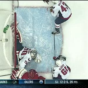 Braden Holtby kicks out pad at last second