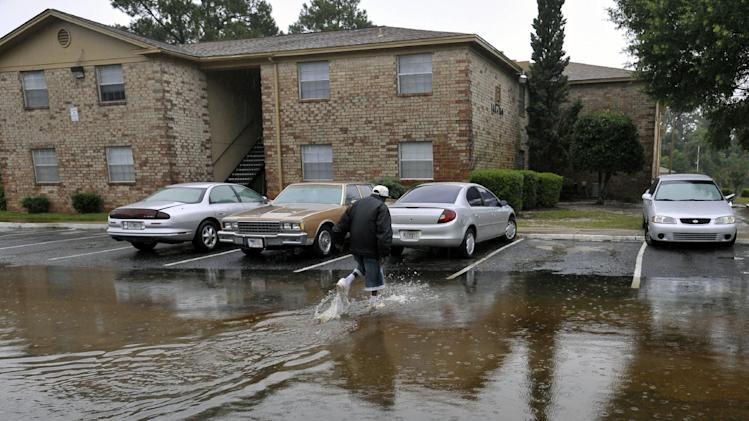 Forest Creek apartment resident Calvin Grace checks on the flooding conditions at his unit Sunday, June 10, 2012, after receiving nearly two feet of water on Saturday, in Pensacola, Fla. Floodwaters from torrential rains damaged homes and closed roads throughout the Florida Panhandle, cutting power to the county jail and sending residents to emergency shelters as the area braced for additional rains Sunday. (AP Photo/The Pensacola News Journal, Tony Giberson)  NO SALES; MANDATORY CREDIT: TONY GIBERSON/PENSACOLA NEWS JOURNAL AND PNJ.COM