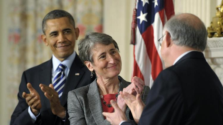 President Barack Obama and his Interior Secretary nominee REI Chief Executive Officer Sally Jewell, center, applaud outgoing Interior Secretary Ken Salazar, Wednesday, Feb. 6, 2013, in the State Dining Room of the White House in Washington. (AP Photo/Susan Walsh)