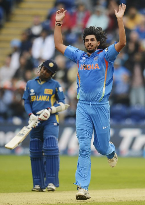 India's Sharma celebrates after dismissing Sri Lanka's Sangakkara during the ICC Champions Trophy semi-final match in Wales