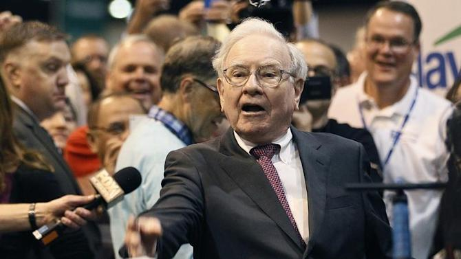 Berkshire Hathaway CEO Buffett throws a newspaper during a competition at a trade show, at the company's annual meeting in Omaha