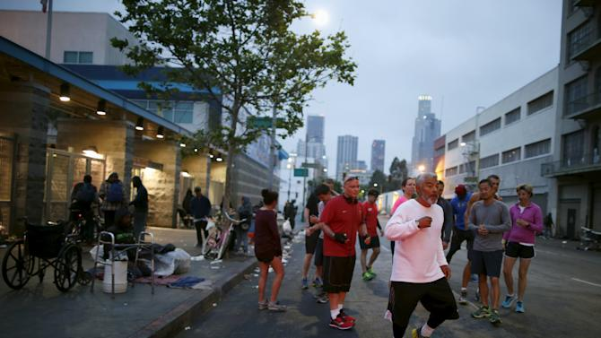 Runners from the Midnight Mission Running Club begin a sunrise run through skid row in Los Angeles