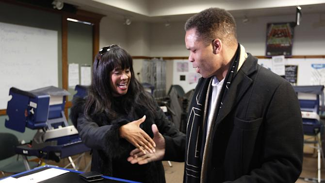 """FILE - In this March 9, 2012 file photo, then-U.S. Rep. Jesse Jackson Jr.,and his wife, Chicago Alderman Sandi Jackson, ask each other for their support and votes as they arrive at a polling station for early voting in Chicago.  Alderman Sandi Jackson on Friday, Jan. 11, 2013 announced she is resigning from the Chicago City Council. In a letter to Mayor Rahm Emanuel, she said that she could not adequately represent her district """"while dealing with very painful family health matters."""" Rep. Jackson recently resigned from Congress while being treated for bipolar disorder and other medical issues. (AP Photo/M. Spencer Green, File)"""