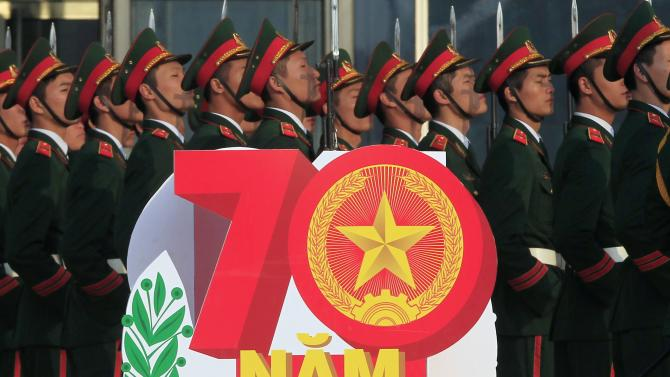 Soldiers stand during celebrations to commemorate the 70th anniversary of the establishment of the Vietnam People's Army in Hanoi