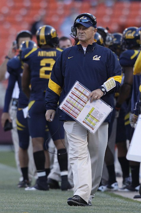 FILE - In this Sept. 3, 2011, file photo, California head coach Jeff Tedford walks the sideline during NCAA college football game against Fresno State in San Francisco. Tedford was fired on Tuesday, N