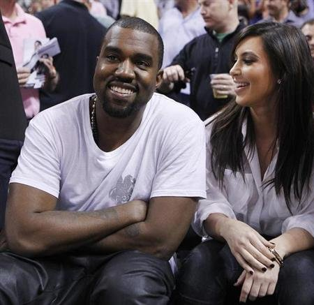 Rap musician West is and reality TV star Kardashian watch Miami Heat play New York Knicks in their NBA basketball game in Miami