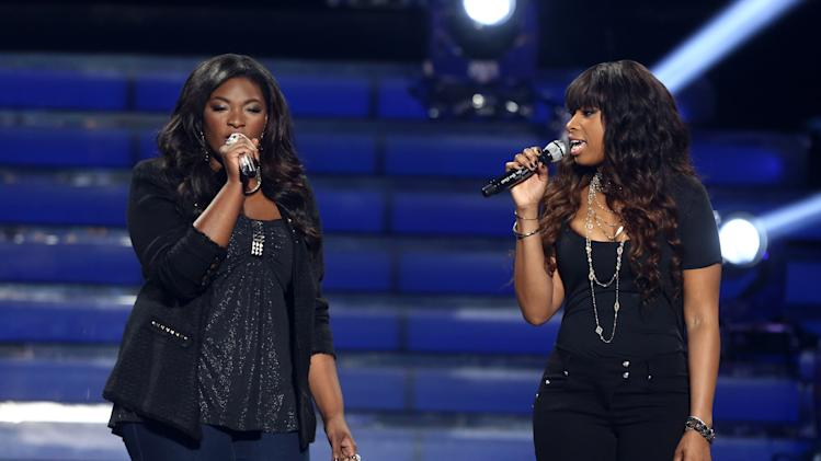 "Finalist Candice Glover, left, and Jennifer Hudson perform at the ""American Idol"" finale at the Nokia Theatre at L.A. Live on Thursday, May 16, 2013, in Los Angeles. (Photo by Matt Sayles/Invision/AP)"