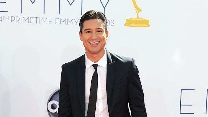 """FILE - In this Sept. 23, 2012 file photo, Mario Lopez arrives at the 64th Primetime Emmy Awards at the Nokia Theatre, in Los Angeles.  Fox's """"The X Factor"""" began airing live episodes Wednesday, Oct. 31, 2012, with new co-hosts Khloe Kardashian and Mario Lopez. (Photo by Matt Sayles/Invision/AP, File)"""