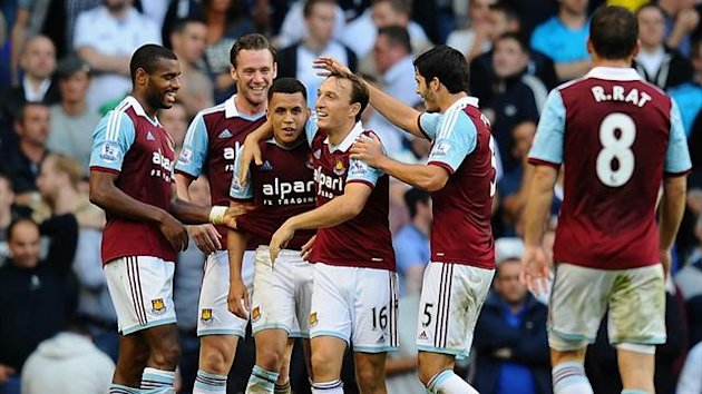 Ravel Morrison of West Ham (3L) is congratulated by team mates after scoring his side's third goal during the Barclays Premier League match between Tottenham Hotspur and West Ham United (Reuters)