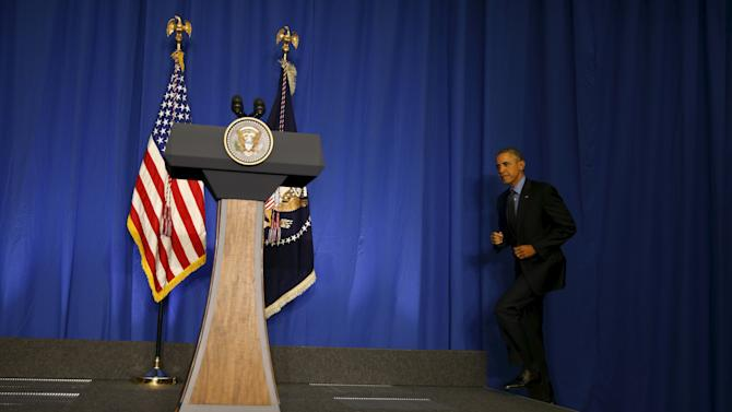 U.S. President Barack Obama Obama takes the stage for a news conference at the conclusion of his visit to Paris