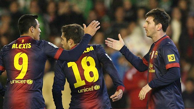 Barcelona's Lionel Messi from Argentina, right, celebrates with teammate Alexis Sanchez, left, after scoring against Betis during their La Liga soccer match at the Benito Villamarin stadium, in Seville, Spain on Sunday, Dec. 9, 2012. (AP Photo/Angel Fernandez)