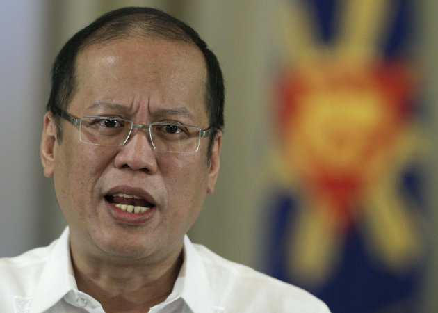 Philippine President Benigno Aquino III delivers a speech on national television at the Malacanang Presidential Palace in Manila, Philippines on Sunday, Oct. 7, 2012. Aquino said Sunday that his government has reached a preliminary peace agreement with the nation's largest Muslim rebel group in a major breakthrough toward ending a decades-long insurgency in the country's south. (AP Photo/Aaron Favila)