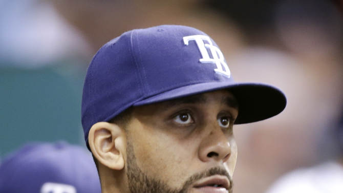 Tampa Bay Rays starting pitcher David Price looks out of the dugout during the fourth inning of a baseball game against the Boston Red Sox on Thursday, May 16, 2013, in St. Petersburg, Fla. Price went on the disabled list Thursday for stiffness in his arm. (AP Photo/Chris O'Meara)