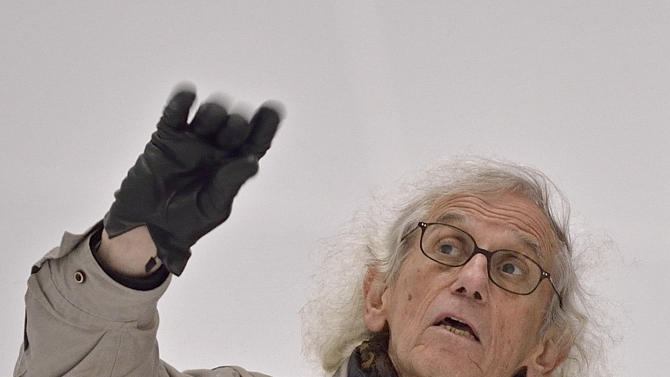 In this picture taken March 13, 2013 International artist Christo gestures inside his 'Big Air Package' artwork at the Gasometer in Oberhausen, Germany, as he visits his work two days before the official opening of the exhibition on March 15, 2013. Christo's latest monumental sculpture in the interior of the industrial monument reaches a height of more than 90 metres, a diameter of 50 metres and a volume of 177,000 cubic metres. The  world's largest self-supporting sculpture will be on show for the public from March 16 until Dec. 30, 2013. (AP Photo/Martin Meissner)