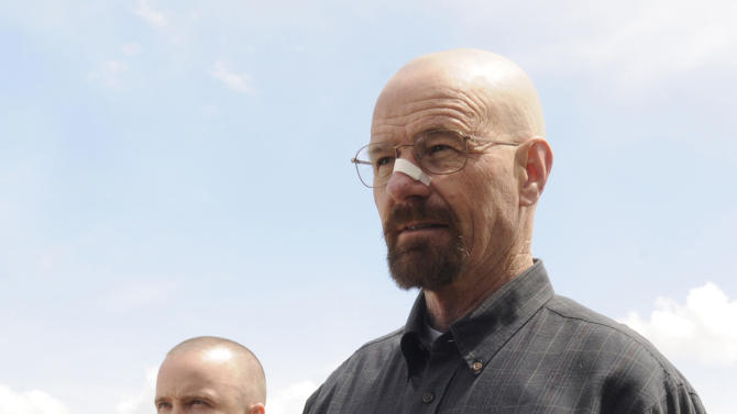 """This image released by AMC shows Bryan Cranston as Walter White, right, and Aaron Paul as Jesse Pinkman in a scene from the season 5 premiere of """"Breaking Bad,"""" airing Sunday, July 15, at 10 p.m. EST on AMC. (AP Photo/AMC, Ursula Coyote)"""