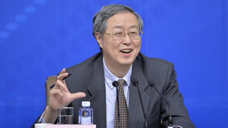 China's central bank governor Zhou gestures as he speaks at a news conference as part of the NPC in Beijing