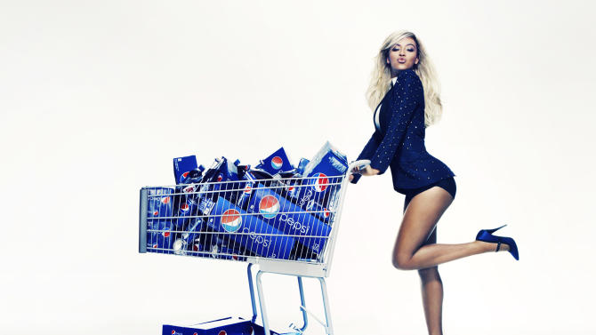 """This Oct. 23, 2012 publicity photo provided by Pepsi shows Beyonce during a Pepsi Print photo shoot at Canoe Studios in New York. This image will appear as life-size standees in stores starting first quarter 2013, as an extension of the brand's """"Live For Now"""" campaign. Through a photo contest, 100 fans will join Beyonce onstage during the singer's halftime show performance at the 2013 Super Bowl on Feb. 3, 2013, at the Mercedes-Benz Superdome in New Orleans. (AP Photo/Pepsi, Patrick Demarchelier)"""