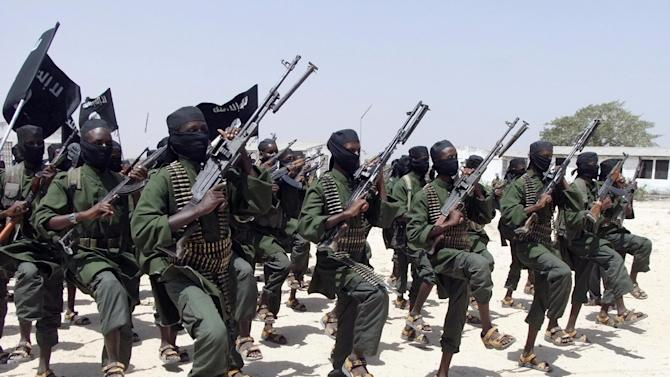 FILE - In this Thursday, Feb. 17, 2011 file photo, hundreds of newly trained al-Shabab fighters perform military exercises in the Lafofe area some 18 km south of Mogadishu, in Somalia. A Somali military official said Tuesday, Sept 1, 2015 that al-Shabab Islamic extremists have attacked an African Union (AU) base in the small farming town of Janale in southern Somalia. (AP Photo/Farah Abdi Warsameh, File)