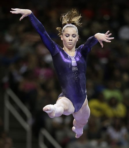 Sore foot forces world vault champ to take it easy