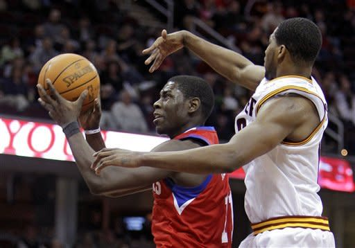 Holiday leads 76ers past short-handed Cavs 99-84