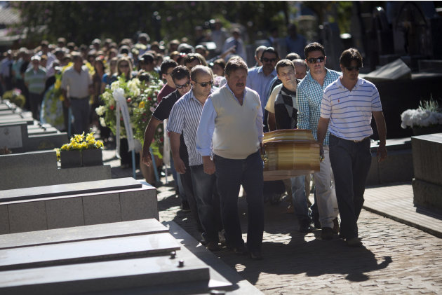 Relatives and friends carry the coffins of two brothers, Pedro and Marcelo Salla, who died in a nightclub fire, as they prepare to bury them at a cemetery in Santa Maria, Brazil, Monday, Jan. 28, 2013