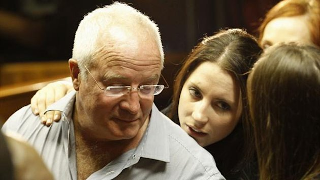 Oscar Pistorius's sister Aimee and father Henke confer during a break in court proceedings (Reuters)