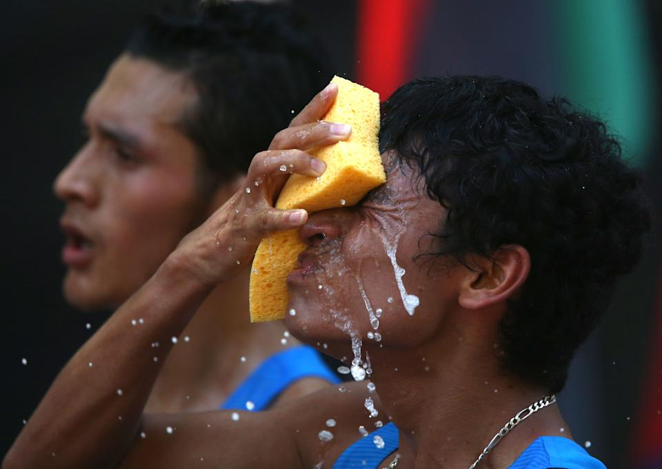 Erick Barrondo, of Guatemala, refreshes himself during the men's 50-kilometer race walk at the 2012 Summer Olympics, Saturday, Aug. 11, 2012, in London. (AP Photo/Sergei Grits)