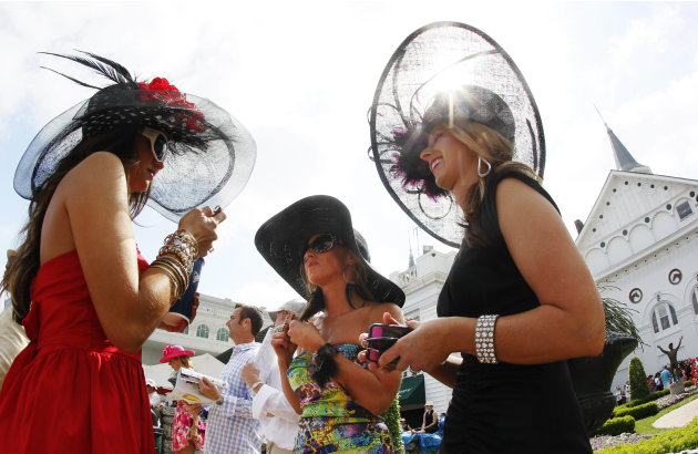 From left, Amanda Lear, from Ruby, S.C., Amada Griffo, of Wapakoneta, Ohio, and Sara Coucher, of Frederickstown, Ohio, chat in the paddocks before the 138th Kentucky Derby horse race at Churchill Down